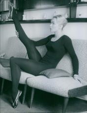 Claude Bessy stretching her leg.