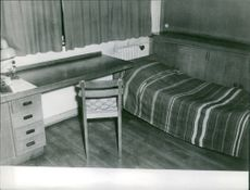 A room with bed,table and chair, 1961.