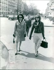 Princess Soraya walking with Woman on street.