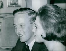 Johann Georg and Princess Birgitta sitting together and communicating with each other.1960