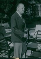 """British playwright and novelist W. Somerset Maugham standing in his villa """"La Mauresque"""" after return from Greece, he looking at somewhere"""