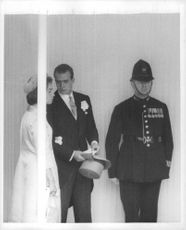A couple from a Royal clan talking beside the royal guard.  - Apr 1963