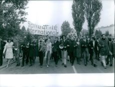 A photo of French-German Politician Daniel Marc Cohn-Bendit leads French students in a protest.