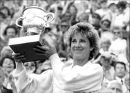 Chris Evert holds up the cup after the win in French Open 1985