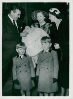 Jack Hawkins with his wife and children and their godmother at the baptism of the least