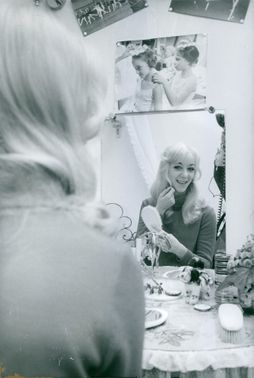 A woman smiling on the mirror.