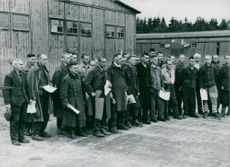 A group of German soldiers prisoners holding papers have been released after 2 years. 1947.