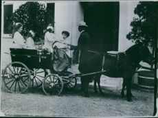Princess Alexandra,The Honorable Lady Ogilvy, on a horse cart in her early age.