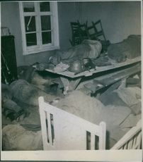 Soldiers lying everywhere in a room  tries to get some sleep during Finnish War, 1944.