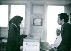 A woman casts her vote. 1977