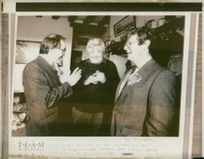 Charles Prior (R) discussing with Michael Howard (L)