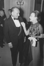 The Duchess of Windsor in a conversation with a man at a function.