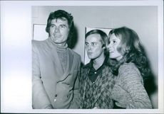 Tom Tyron, Paul Hauge and Stefanie Powers get together at the opening of Hauge's one man show at the Mckenzie Gallery in Hollywood.