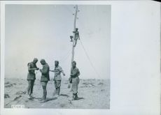 Soldiers restoring the phone lines in the immediate rear of the Italian deployment on the Libyan - Egyptian border, 1941.