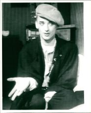 Boy George gesturing his hand during an interview