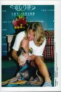 Steffi Graf plays with dog after tennis tournament Kay Biscayne