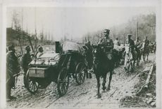 Soldiers riding in the field while carrying a things in the chariot during Tyskland war.
