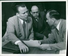 A group of men in a discussion.