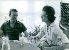 Princess Desiree siting with her husband Niclas silfverschiold and drinking.