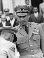Mohammad Reza Pahlavi Army member kissing his hand.