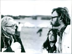 Men and woman talking during the 1970 Pop Festival in the Yard.