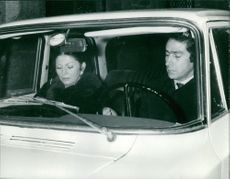Princess Soraya sitting in a car with a man.