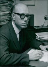 Lars Noroskov Nielsen writing on a paper, 1971.