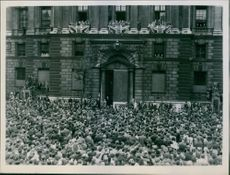 Huge crowd listening to Mr. Churchhill's speech outside the ministry of health, 1945.