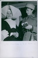 Lis Asklund and Sister Stanislava standing together while having a discussion in Poland, 1946.