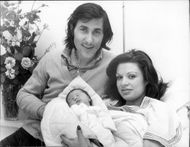 The tennis player Ilie Nastase together with the wife of Dominique and their newborn baby