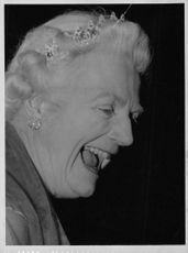Clementine Churchill laughing.