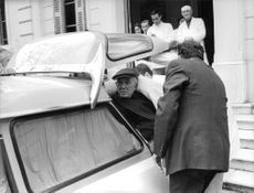 Vincent Jules Auriol being taken into the ambulance.
