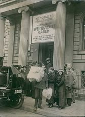 People gathered in front of building during World War I.
