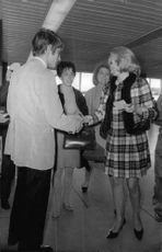 Carroll Baker shaking hand with man.