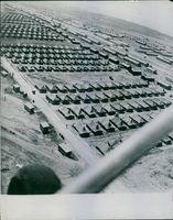 A bird's eye view of the tents and barracks.
