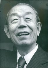 Prime Minister of Japan, Taked Fakuda smiling.