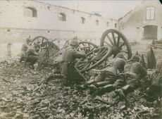 Soldiers firing at the enemy during wartime.