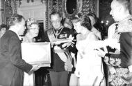 Juliana, Bernhard and Beatrix of the Netherlands looking at the gift.