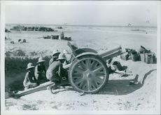 Front of Tobruk: British cannon captured and facing enemy positions.