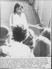 Tennis player Ilie Nastase is battling with the referee at Wimbledon