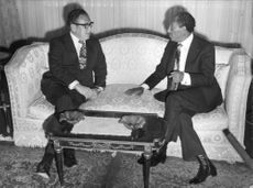 Henry Alfred Kissinger sitting with the President Anwat al Sadat of Egypt, conversing in Cairo.