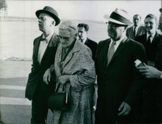 Portrait of an American pilot Francis Gary Powers walking, being assisted by men 1960