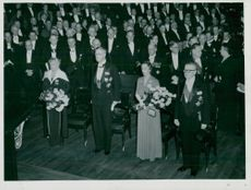 The King of Sweden King Kung Gustaf VI Adolf and Queen Louise together with the Presidential Party on Promotion in the University of Prorector Prof. Myrberg.