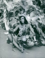 Tribal woman wearing feather clothes.