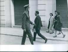Photo of Juan Carlos of Spain walking.