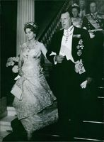 A photo of Infante Juan, Count of Barcelona with his wife Princesa María de las Mercedes of Bourbon-Two Sicilies walking the aisle in an event attended.