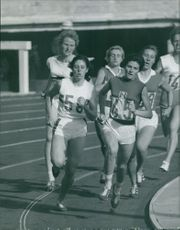 Women racing for a marathon.
