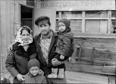 Portrait image of a newbuilder family in Siberia.