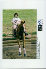 Blyth Tait may not be the coolest style when he and the horse Ready Teddy propel the water barrier in the terrain.