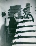Georges Bidault with a huge collection of guns.